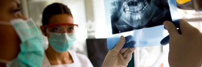 Canadian dentist viewing x-ray